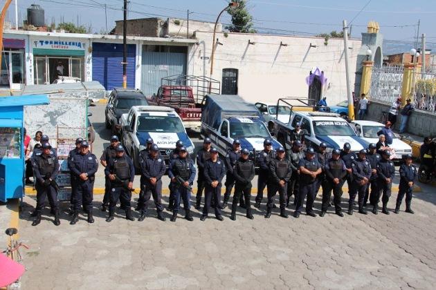 Elementos de la subordinación de Seguridad Pública y Tránsito Municipal de Xalmimilulco FOTO: Cortesía